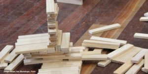 pictures of wooden blocks some stacked on top of each other and some laying flat on the floor